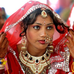An Indian bride sits during a mass marri